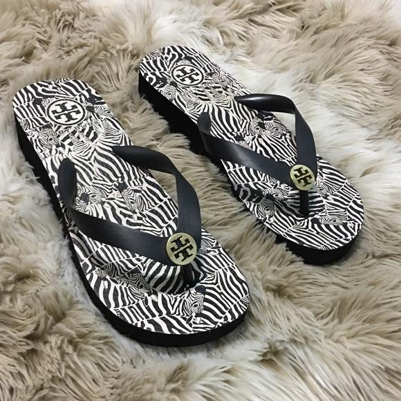 382919344f1a5f Tory Burch Shoes - Tory Burch Wedge Zebra Flip Flops size 5